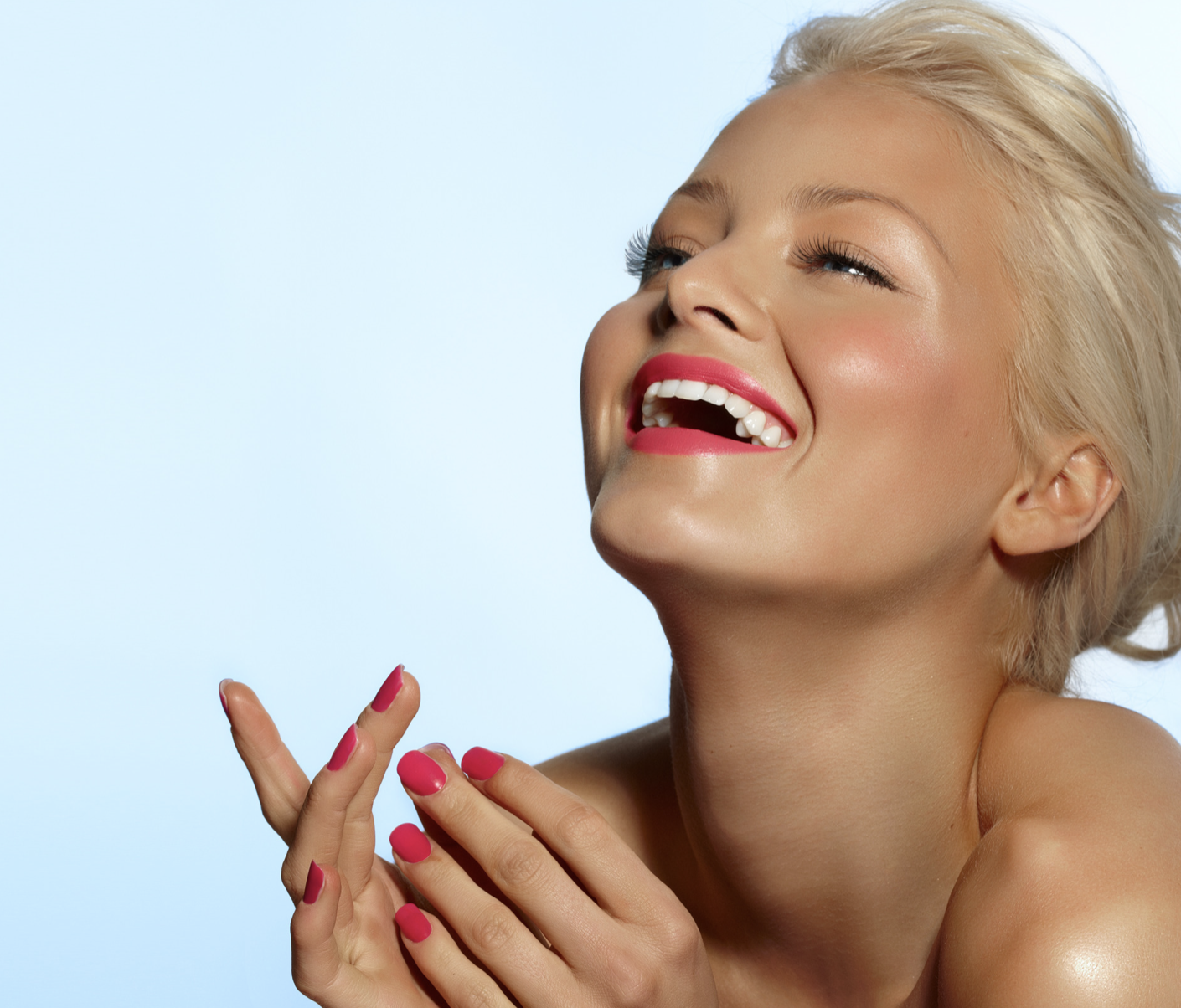 Blonde girl with red nails laughing