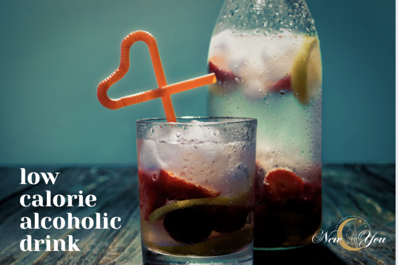 Alcoholic fruit drink with an orange heart straw
