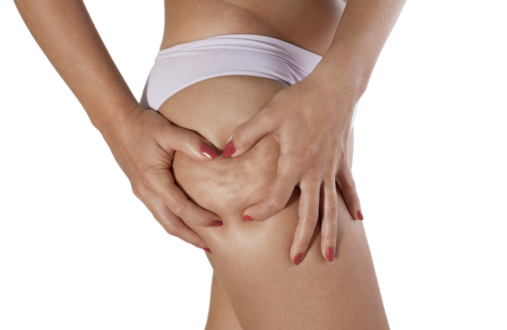 Close up image of a woman squeezing her upper thigh