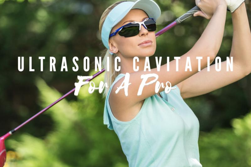 Woman in light blue shirt and visor swinging a golf club